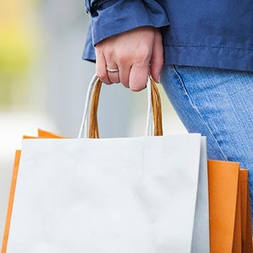 Consumer with shopping bags