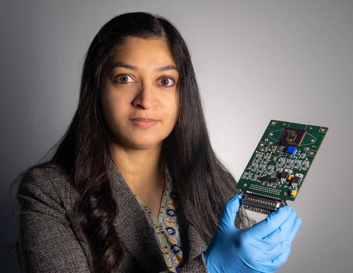NASA Technologist holding an autonomous multifunctional sensor platform